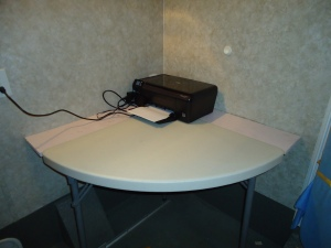 "It is a quarter round desk.  Note that against the walls we installed  1"" x 8"" boards.  We will take the table down during moving days, and the 1"" x 8"" boards will hold the printer and other items."