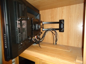 The larger living room TV required a larger mount.  All the cable go to a management system under the TV
