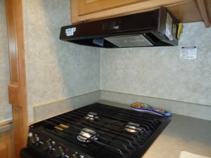 Kitchen project installing splash shields around stove.