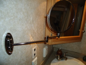 Our afternoon project was mounting this mirror in the bathroom.  It magnifies 5 times on one side.