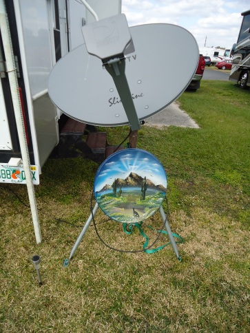 The upper dish is our HD DirecTv dish.  It can be a bear to sit up as you have to hit 3 satellites.  The older dish we had custom painted in Mexico in 2003.