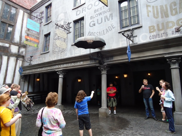 This girl is trying to make rain come out of the umbrella.  The interactive wands were added in 2014 and start at $45.  As of today there are over 60 different wands for sale with some people owning them all.