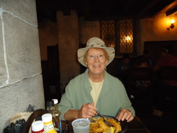 Peggy eating  fish and chips at the Leaky Cauldron.